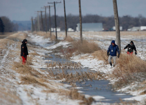ohn Woods / The Canadian Press Volunteers search through a ditch beside a farmers' field hoping to find 2-year-old Chase Martens near Austin, Man., on Friday, March 25, 2016. An overnight snowfall is making the search, a race against time in locating the missing boy, even more difficult.