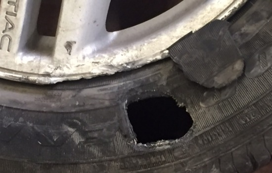 Example of tire damaged recently by potholes. Vehicle brought in to CAA Car Care Centre.