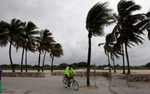 A man rides his bicycle along the beach prior to the arrival of Hurricane Matthew in Miami Beach